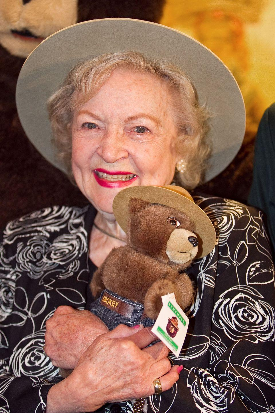 """<p>With three Emmy awards and more than six decades in the entertainment industry, Betty fulfilled a lifelong dream when she was made an honorary forest ranger in 2010. As a child, she dreamed of becoming a park ranger or zookeeper, but one thing stood in her way. """"Back then, girls were not allowed to become forest rangers,"""" she told <a href=""""http://abcnewsradioonline.com/entertainment-news/2010/11/9/actress-betty-white-made-honorary-us-forest-ranger.html"""" rel=""""nofollow noopener"""" target=""""_blank"""" data-ylk=""""slk:ABC News"""" class=""""link rapid-noclick-resp"""">ABC News</a>. </p>"""