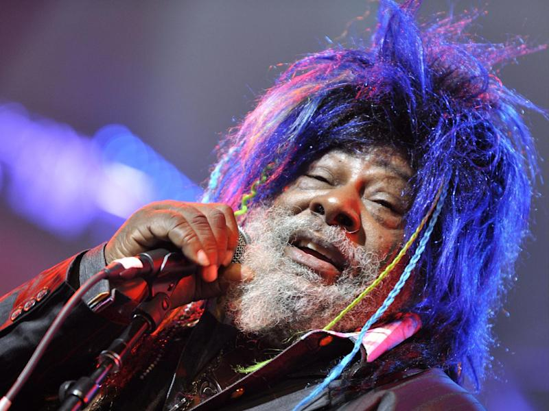 FILE - In this Nov. 12, 2009 file photo, American singer, songwriter and music producer George Clinton performs with the funk, soul and rock music collective Parliament-Funkadelic on stage at the Avo Session in Basel, Switzerland. Clinton and the Black Eyed Peas have settled a lawsuit in which the funk pioneer accused the pop group of improperly sampling his music. (AP Photo/Keystone, Georgios Kefalas, File)