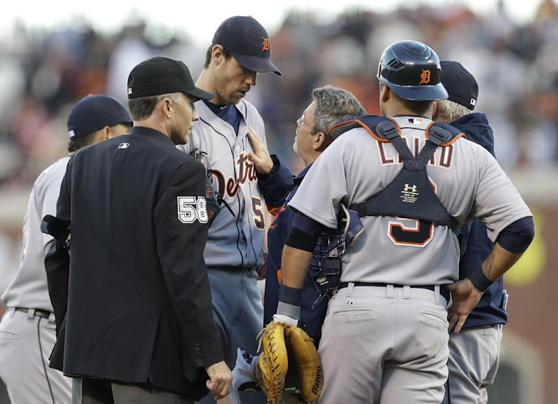 Detroit Tigers' Doug Fister is examined after being hit by a ball off the bat of San Francisco Giants' Gregor Blanco during the second inning of Game 2 of baseball's World Series Thursday, Oct. 25, 2012, in San Francisco. (AP Photo/Marcio Jose Sanchez)