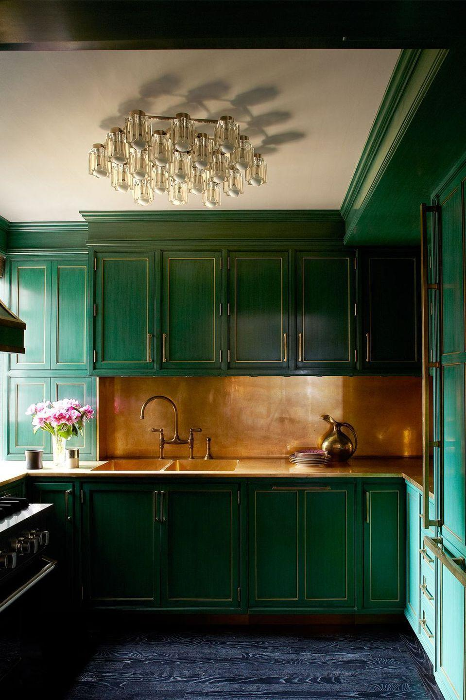 """<p>This bold color trend actually may have started a few years ago in <a href=""""https://www.elledecor.com/celebrity-style/celebrity-homes/news/g498/cameron-diaz-manhattan-apartment/?slide=4"""" rel=""""nofollow noopener"""" target=""""_blank"""" data-ylk=""""slk:Cameron Diaz"""" class=""""link rapid-noclick-resp"""">Cameron Diaz</a>'s Kelly Wearstler–designed home, but green cabinets took on a new cult following this past year thanks to Gen Z's worship (on TikTok, of all places) of Dakota Johnson's alligator green kitchen. The green tones may be more muted nowadays, but it's clear that this color family is here to stay. </p>"""