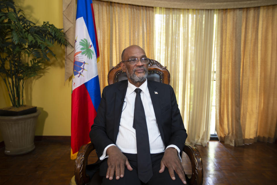 Haiti's Prime Minister Ariel Henry attends an interview with the Associated Press at his private residence in Port-au-Prince, Tuesday, Sept. 28, 2021. (AP Photo/Joseph Odelyn)