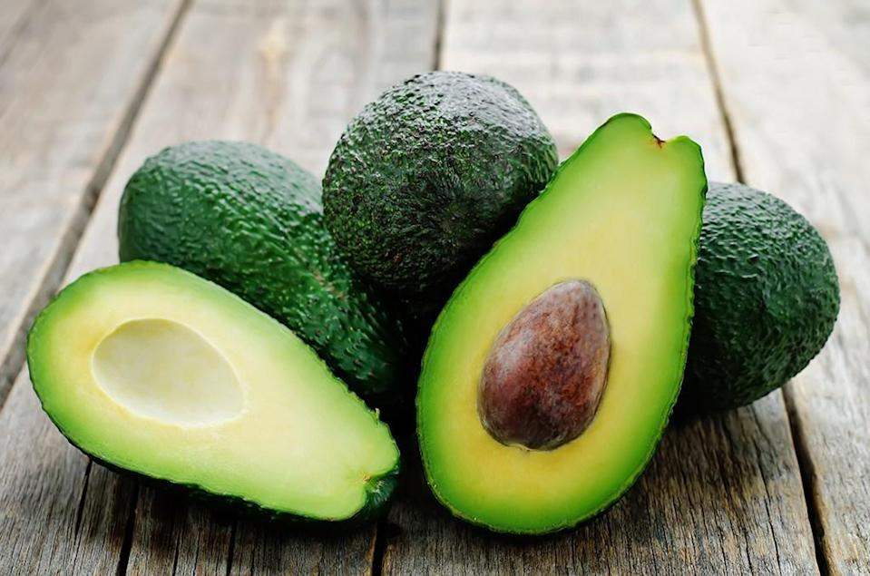 """Need some extra incentive to pay more for that guac at Chipotle? Just tell yourself it's for your health. A 2017 study published in the journal <em>Nutrition</em> found that <a href=""""https://www.fasebj.org/doi/abs/10.1096/fasebj.31.1_supplement.433.6"""" rel=""""nofollow noopener"""" target=""""_blank"""" data-ylk=""""slk:eating avocado with meals"""" class=""""link rapid-noclick-resp"""">eating avocado with meals</a> reduced study participants' hunger and curbed their desire to eat for a six-hour period. So adding this green fruit could make it easier to <a href=""""https://bestlifeonline.com/weight-loss-motivation-tips/?utm_source=yahoo-news&utm_medium=feed&utm_campaign=yahoo-feed"""" rel=""""nofollow noopener"""" target=""""_blank"""" data-ylk=""""slk:shed those stubborn pounds"""" class=""""link rapid-noclick-resp"""">shed those stubborn pounds</a> that tend to stick around as you age."""
