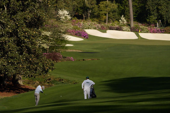 Justin Thomas hits from the fairway on the 13th hole during a practice round for the Masters golf tournament on Tuesday, April 6, 2021, in Augusta, Ga. (AP Photo/David J. Phillip)