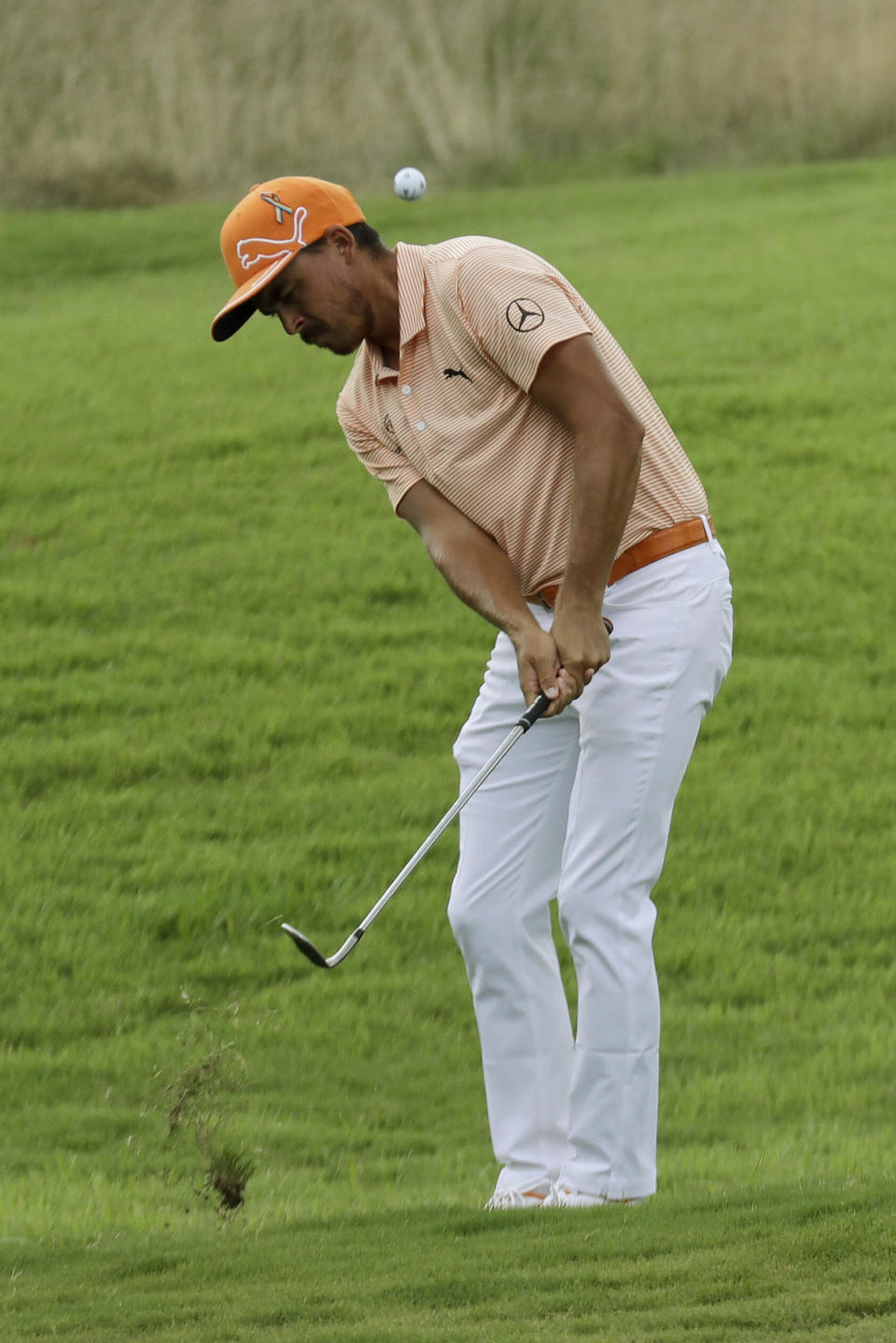 Rickie Fowler hits from the rough on the seventh hole during the final round of the World Golf Championship-FedEx St. Jude Invitational Sunday, Aug. 2, 2020, in Memphis, Tenn. (AP Photo/Mark Humphrey)