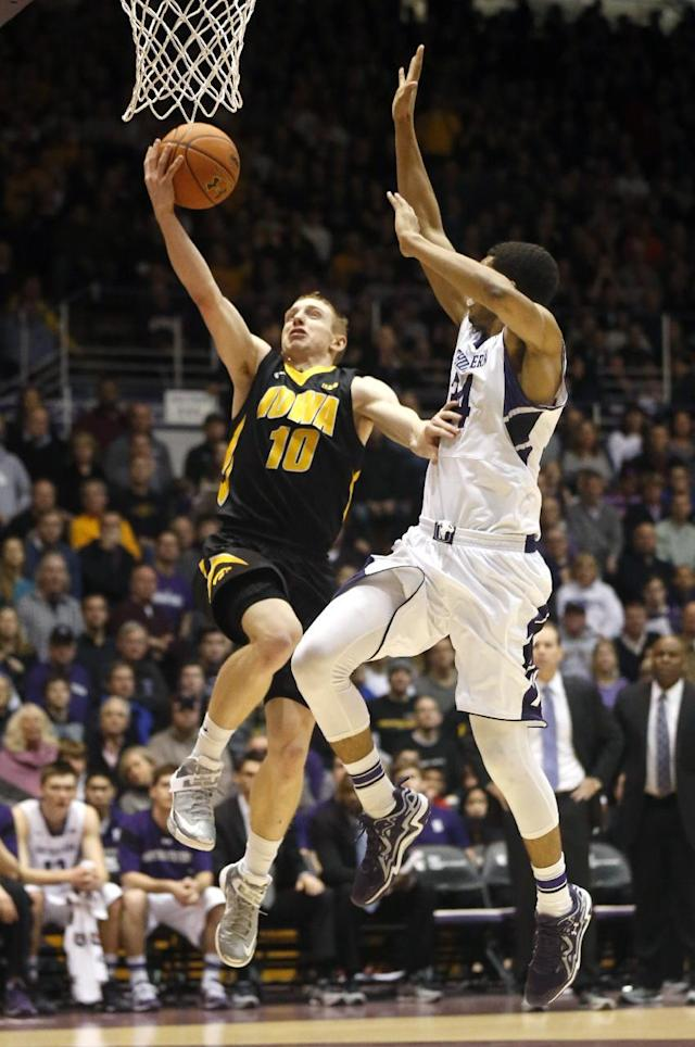 Iowa guard Mike Gesell (10) drives past Northwestern guard Sanjay Lumpkin during the first half of an NCAA college basketball game Saturday, Jan. 25, 2014, in Evanston, Ill. (AP Photo/Charles Rex Arbogast)