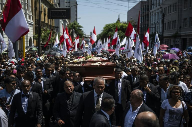 Close aides to Peruvian ex-president Alan Garcia, who committed suicide, carry his casket accompanied by thousands of APRA party loyalists in a downtown Lima funeral procession