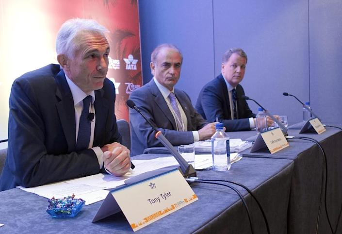 Global airline executives address reporters at the 71st IATA Annual General Meeting and World Air Transport Summit in Miami Beach, Florida, on June 8, 2015 (AFP Photo/Kerry Sheridan)