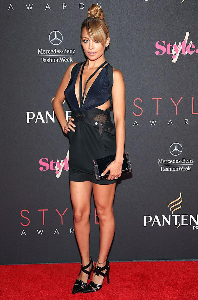"""And last but not least we have Nicole Richie, who opted for a semi-salacious Anthony Vaccarello frock, top knot, and witchy heels for this year's Style Awards. Do you think she deserves to be a mentor on NBC's """"Fashion Star""""? We not quite sure she belongs on the panel. (9/5/2012)<br><br><a target=""""_blank"""" href=""""http://bit.ly/lifeontheMlist"""">Follow What Were They Thinking?! creator, Matt Whitfield, on Twitter!</a>"""