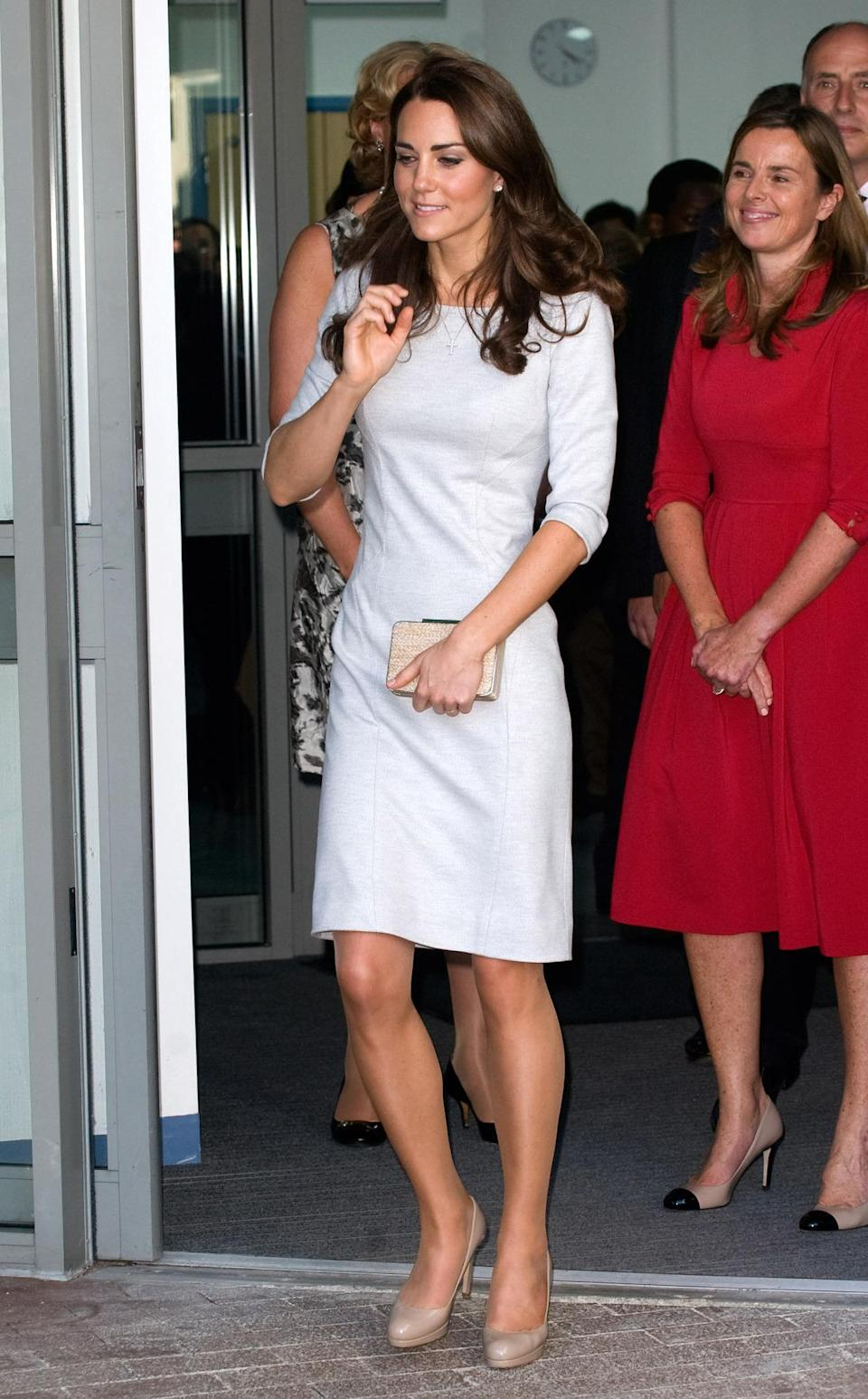 <p>Kate visited Royal Marsden Hospital in a chic fitted dress by Amanda Wakeley. She accessorised with nude pumps and a matching clutch - both from L.K. Bennett.</p><p><i>[Photo: PA]</i></p>