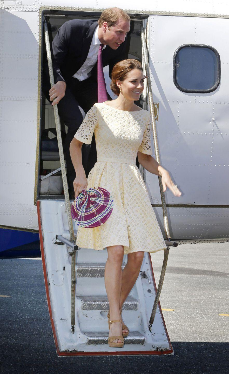 """<p>On a tour of the Pacific in 2012, Kate stepped out wearing a yellow fit-and-flare cotton lace dress, but royal fans couldn't figure out the designer. At the time, people believed that the Duchess chose to wear something unknown to be respectful, since she maybe couldn't find something she liked from the Solomon Islands to honor the country.</p><p>A year later, <a href=""""https://www.harpersbazaar.com.au/fashion/kate-middleton-private-dressmaker-18271"""" rel=""""nofollow noopener"""" target=""""_blank"""" data-ylk=""""slk:the palace revealed"""" class=""""link rapid-noclick-resp"""">the palace revealed</a> that the duchess wore a peach maternity dress made by her """"private dressmaker."""" Fans soon connected the dots. Most people don't have a problem with Kate having a private designer, but some argue it stops from other British businesses benefitting from the """"Kate Middleton"""" effect, in which a company sales rocket after she is seen in one of their items.</p>"""