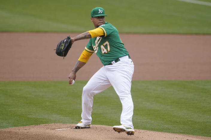 Oakland Athletics' Frankie Montas pitches against the Los Angeles Angels during the first inning of a baseball game in Oakland, Calif., Saturday, May 29, 2021. (AP Photo/Jeff Chiu)