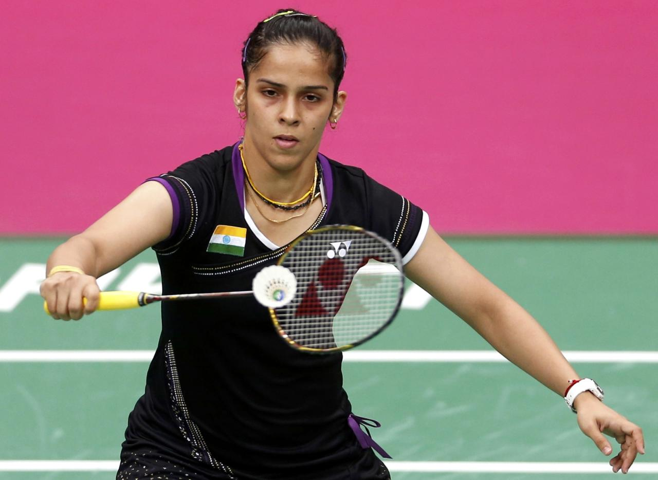 India's Saina Nehwal plays against China's Yihan Wang during their womens singles badminton semifinals match during the London 2012 Olympic Games at the Wembley Arena August 3, 2012. REUTERS/Bazuki Muhammad (BRITAIN  - Tags: SPORT BADMINTON SPORT OLYMPICS)