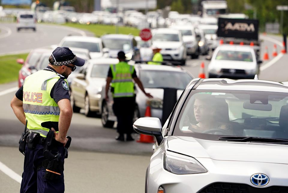 Queensland police question a motorist at the Queensland / New South Wales border checkpoint. Source: AAP