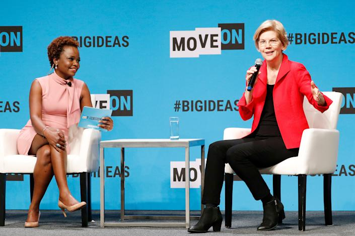 Karine Jean-Pierre, left, chief public affairs officer for MoveOn.org, interviews Sen. Elizabeth Warren, D-Mass., in 2019. Jean-Pierre was picked to be deputy press secretary in President-elect Joe Biden's White House.