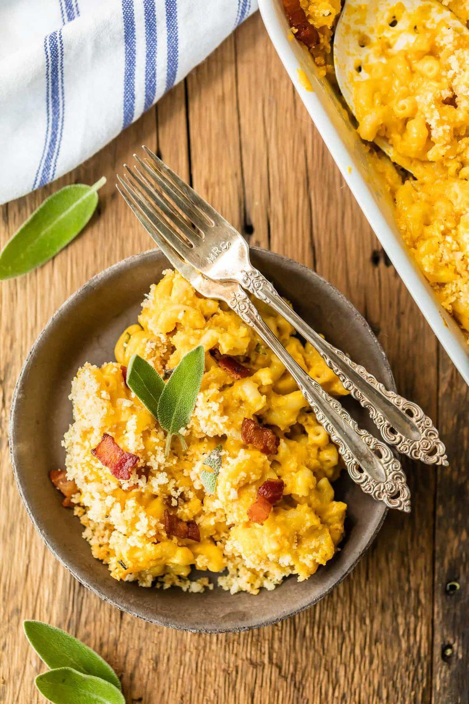 """<p>How do you make mac and cheese <em>even</em> better? Add bacon, mix in pumpkin, and top it all off with bread crumbs!</p><p><strong>Get the recipe at <a href=""""https://www.thecookierookie.com/pumpkin-bacon-mac-cheese/"""" rel=""""nofollow noopener"""" target=""""_blank"""" data-ylk=""""slk:The Cookie Rookie"""" class=""""link rapid-noclick-resp"""">The Cookie Rookie</a>.</strong></p><p><a class=""""link rapid-noclick-resp"""" href=""""https://www.amazon.com/Cuisinart-Classic-Nonstick-Hard-Anodized-Saucepan/dp/B00213JO92?tag=syn-yahoo-20&ascsubtag=%5Bartid%7C10050.g.619%5Bsrc%7Cyahoo-us"""" rel=""""nofollow noopener"""" target=""""_blank"""" data-ylk=""""slk:SHOP SAUCEPANS"""">SHOP SAUCEPANS</a></p>"""