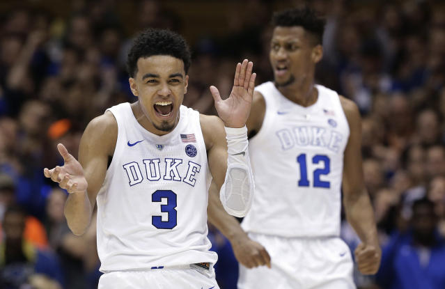 FILE - In this March 5, 2019, file photo, Duke's Tre Jones (3) and Javin DeLaurier (12) react following a play against Wake Forest during the second half of an NCAA college basketball game in Durham, N.C. Tyus Jones led a top-seeded Duke team to a national title four years ago. Now, younger brother Tre wants to do the same thing. (AP Photo/Gerry Broome, File)
