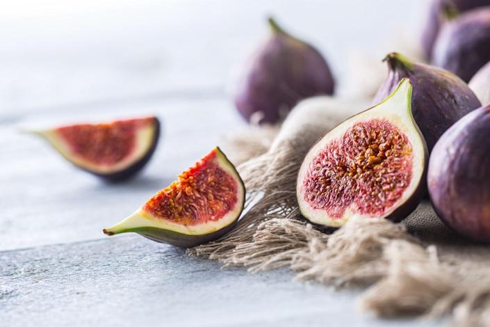 """<p>Figs are """"very high in fiber,"""" Cording says, adding that """"because they're so concentrated, you don't have to eat that many."""" Figs also have an enzyme called ficain that's thought to help with constipation.</p>"""