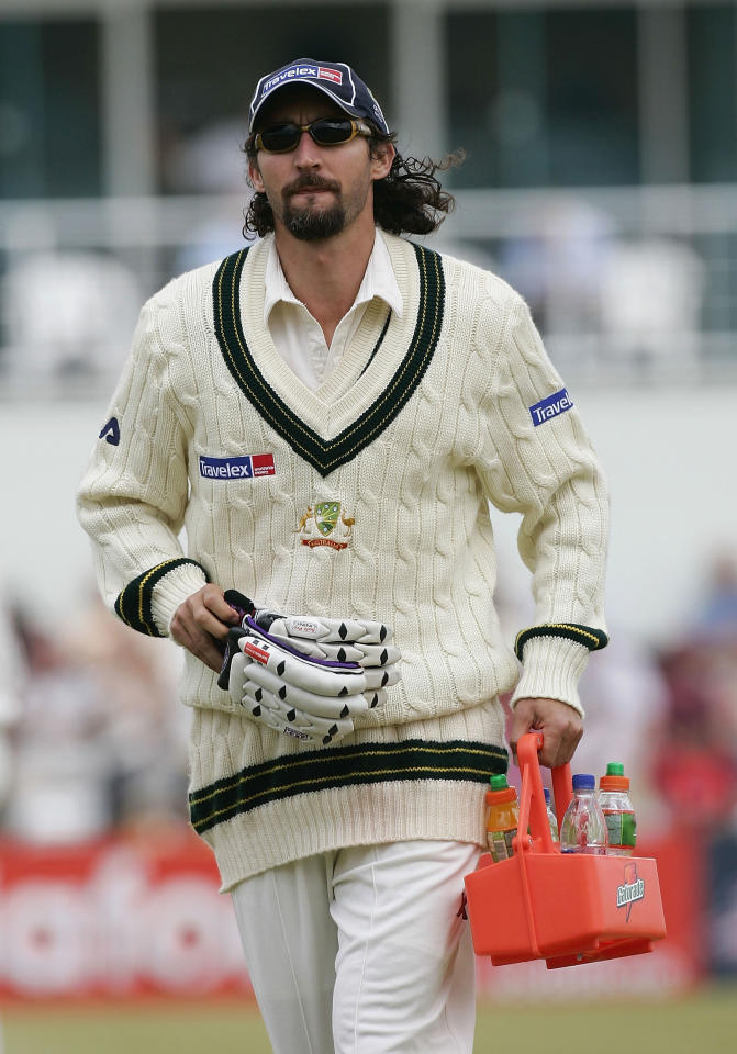 NORTHAMPTON, UNITED KINGDOM - AUGUST 20:  Jason Gillespie of Australia runs drinks from the field during day one of the Tour Match between Northamptonshire and Australia played at the County Ground on August 20, 2005 in Northampton, United Kingdom  (Photo by Hamish Blair/Getty Images)