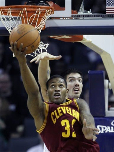 Cleveland Cavaliers' Alonzo Gee, front, shoots over Charlotte Bobcats' Byron Mullens, back, during the first half of an NBA basketball game in Charlotte, N.C., Monday, Jan. 16, 2012. (AP Photo/Chuck Burton)