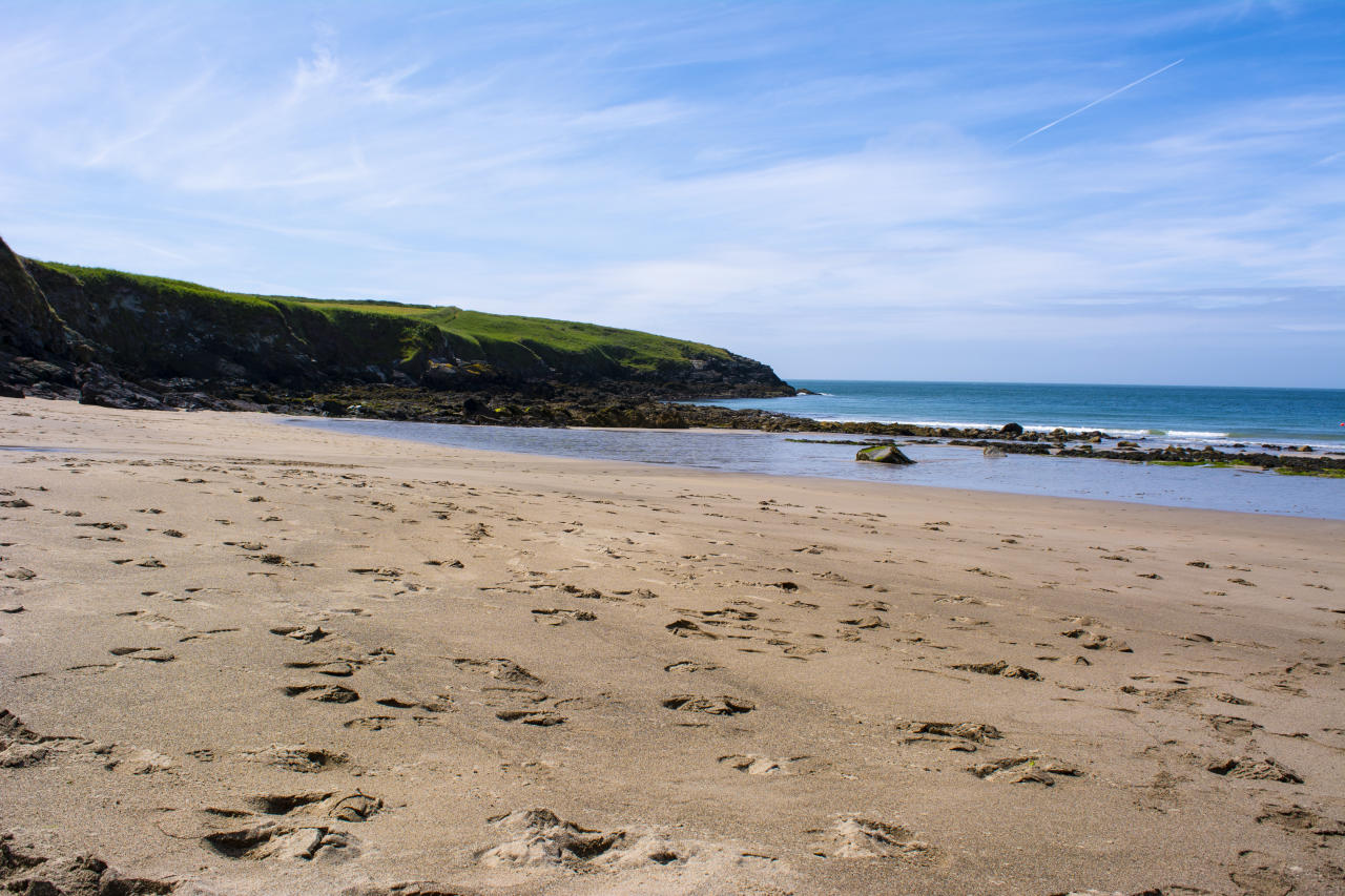 This intimate, sandy cove is sheltered from south-western winds from the surrounding cliffs, making it a perfect spot for sunbathing. When the tides are low, you can walk straight across to the nearby Whitesands Bay in St Davids. [Photo: Getty]