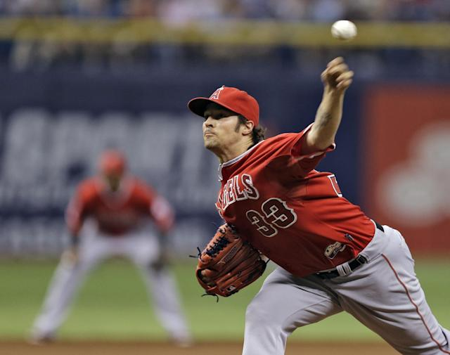 Los Angeles Angels starting pitcher C.J. Wilson delivers to the Tampa Bay Rays during the first inning of a baseball game Saturday, Aug. 2, 2014, in St. Petersburg, Fla. (AP Photo/Chris O'Meara)
