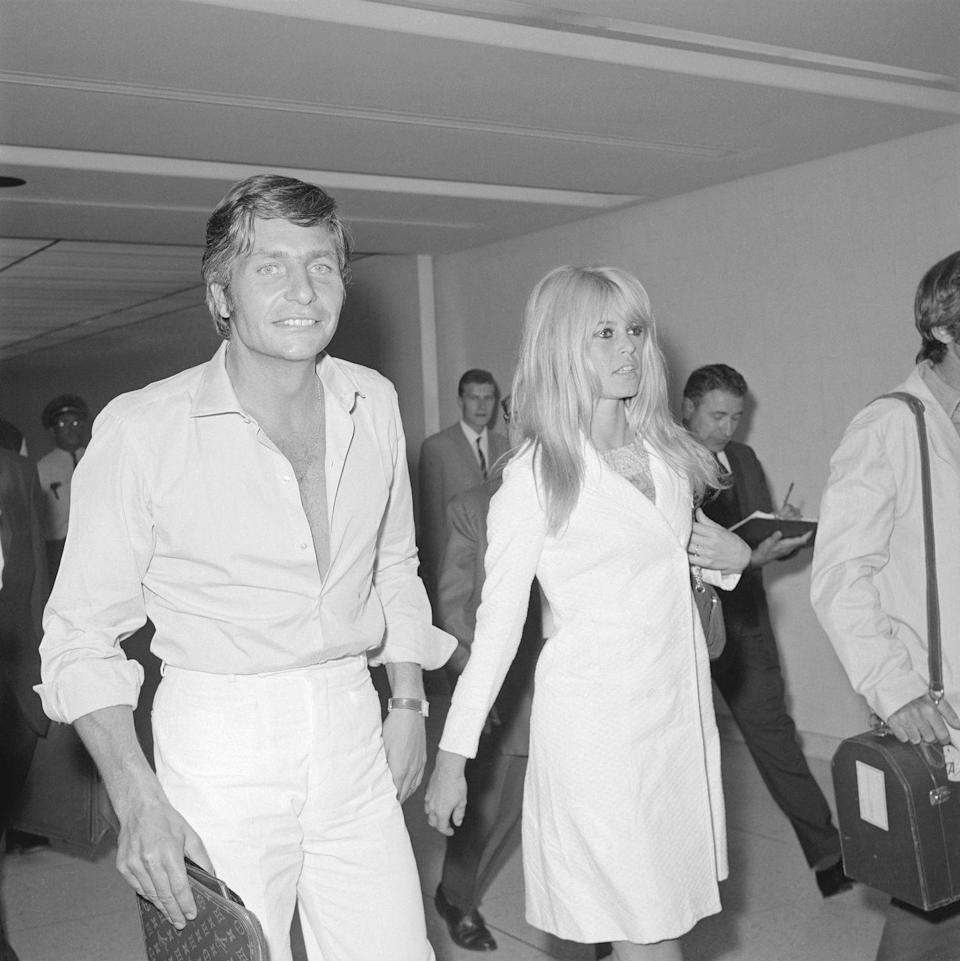 <p>Brigitte Bardot and her third husband, German businessman Gunter Sachs, walk through the airport after eloping in Las Vegas in 1966 a few weeks after they met. They were married for three years. </p>