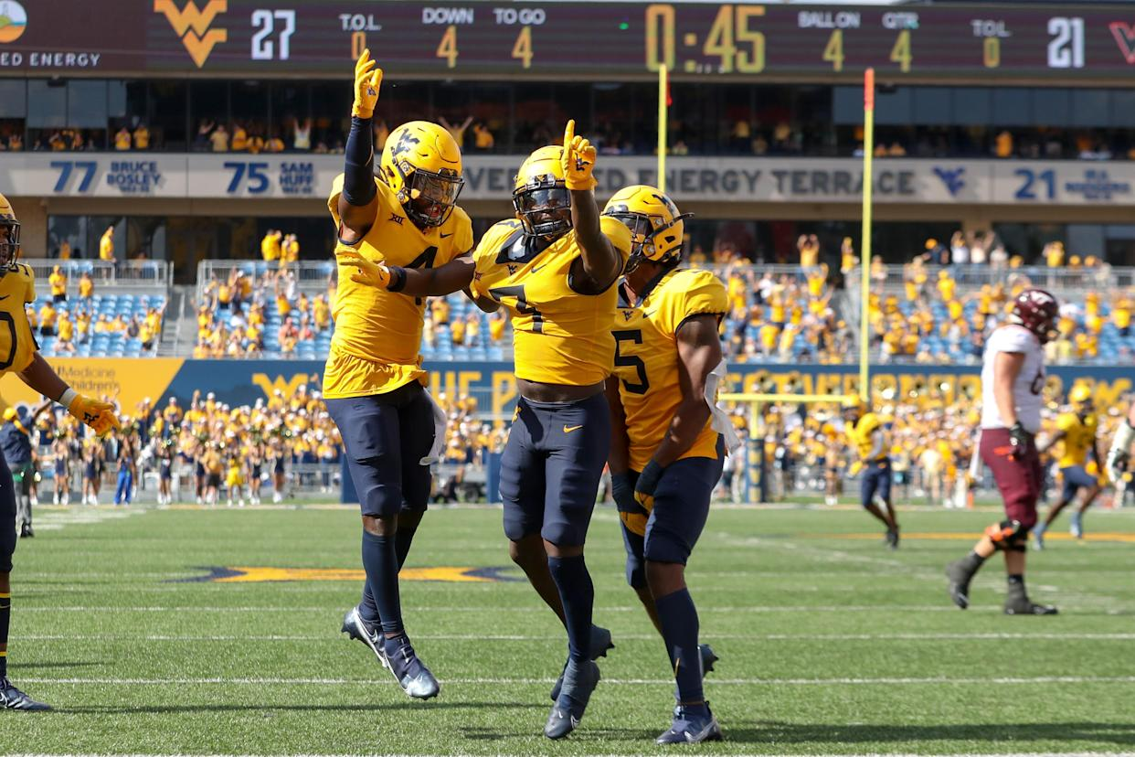 West Virginia Mountaineers safety Alonzo Addae (4), cornerback Jackie Matthews (3) and linebacker Lance Dixon (5) celebrate after Matthews sealed the Mountaineers' victory. (Frank Jansky/Icon Sportswire via Getty Images)