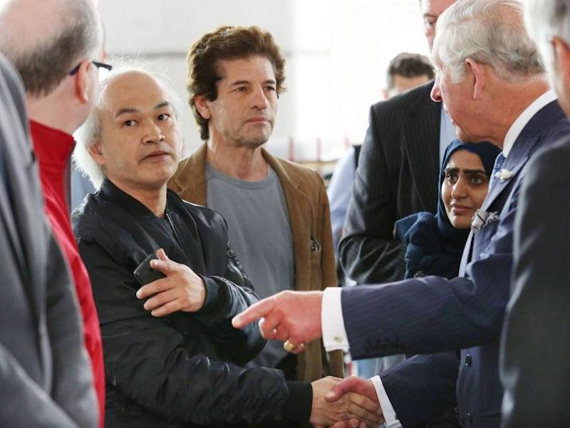 Anh Nhu Nguyen (left, dark shirt) meeting Prince Charles with the real Grenfell victims at the Westway Sports Centre in the aftermath of the disaster: PA