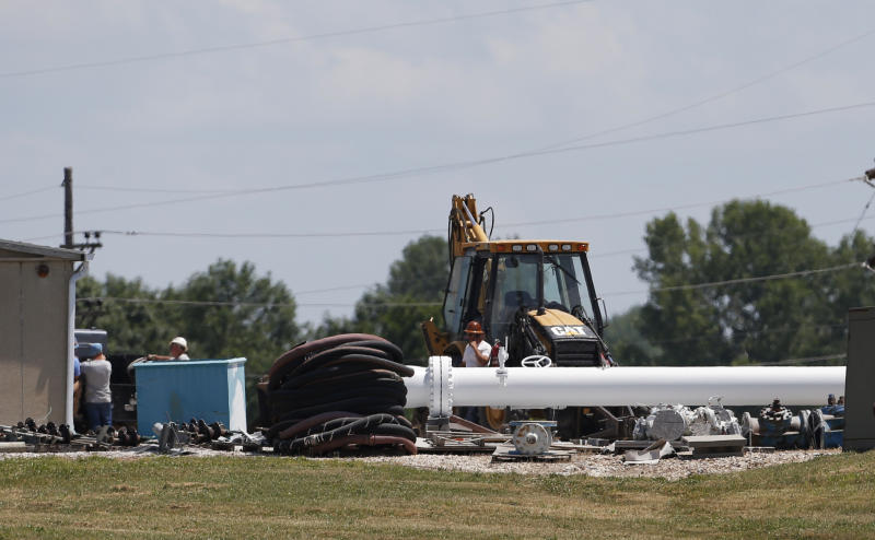 Workers move equipment in the yard at the Enbridge Key Terminal near Salisbury, Mo., Tuesday, July 16, 2013. The company hopes to begin construction of the Flanagan South pipeline in early August. (AP Photo/Orlin Wagner)