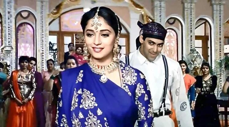 <p>The early nineties saw Madhuri's career shoot up to unimaginable high zones. After making a hit-pair with Anil Kapoor, Madhuri and Salman Khan were the next big thing in the scene. They created a fairy tale every time they appeared on the screen together. We got the roaringly successful <em>Hum Aapke Hain Kaun</em> that registered itself as the most successful Hindi movie of all times and won the diva scores of few fans. Movies like <em>Saajan, Raja, Beta</em> made her the most sought-after actress of this era. </p>