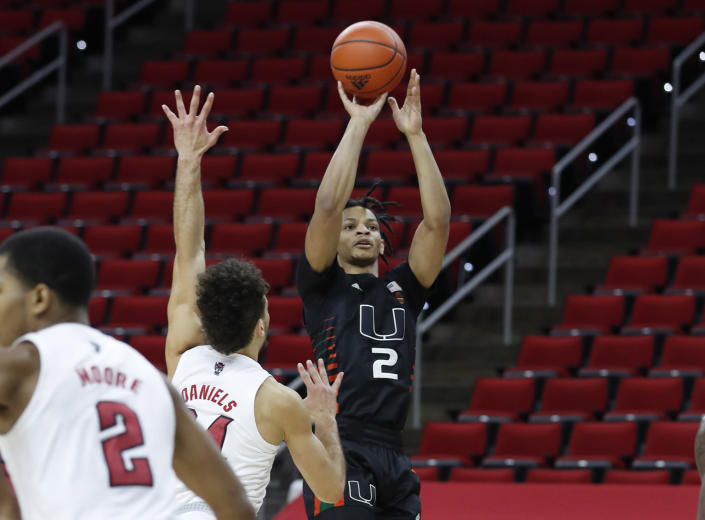 Miam Miami's Isaiah Wong (2) shoots during the first half of an NCAA college basketball game against North Carolina State at PNC Arena in Raleigh, N.C., Saturday, Jan. 9, 2021. (Ethan Hyman/The News & Observer via AP)