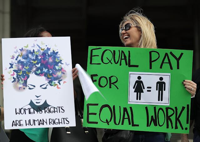 Woman marching for equal pay in Fort Lauderdale, Florida, last year. (Joe Raedle via Getty Images)