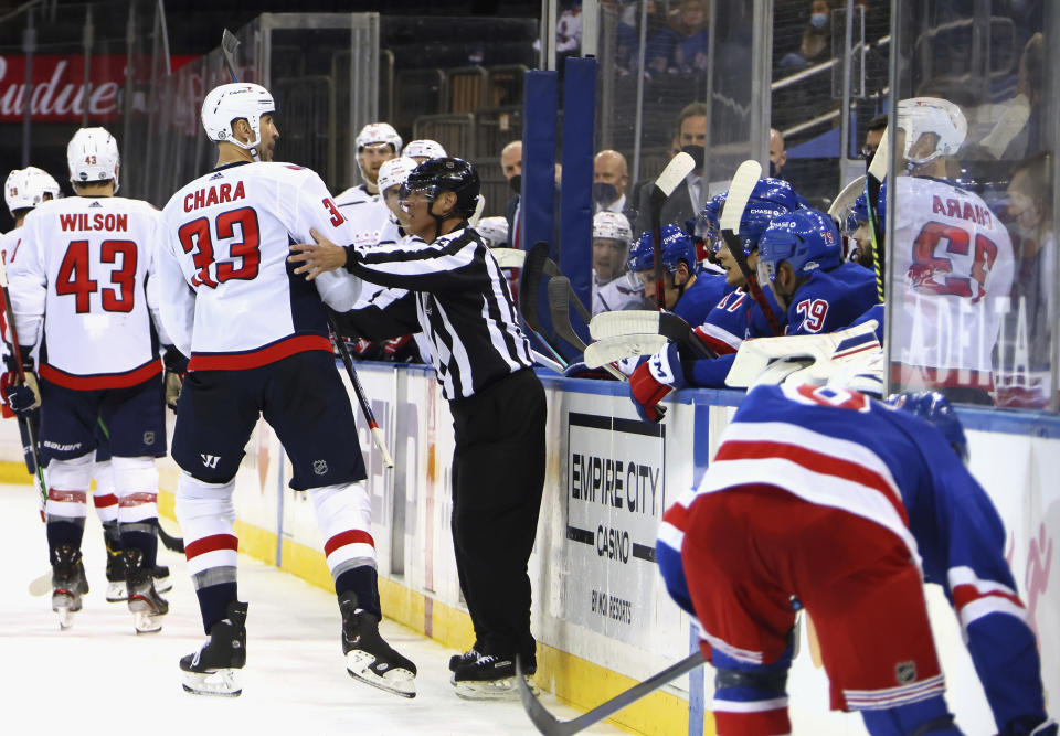 Washington Capitals' Zdeno Chara (33) talks to the New York Rangers' bench during the first period of an NHL hockey game Wednesday, May 5, 2021, in New York. (Bruce Bennett/Pool Photo via AP)