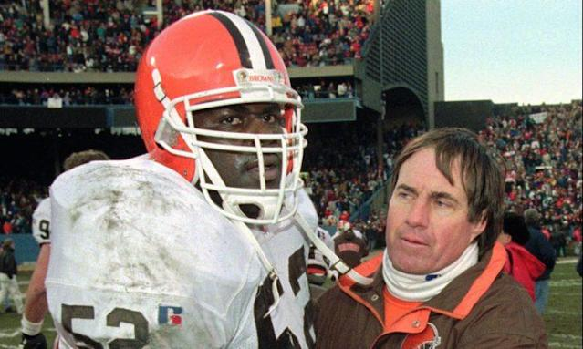 Bill Belichick didn't make the move to Baltimore with the team as he was fired following the Cleveland Browns' 1995 season. Here he congratulates Pepper Johnson after the final game at Cleveland Municipal Stadium Johnson didn't stick with the team either the following season. (AP)