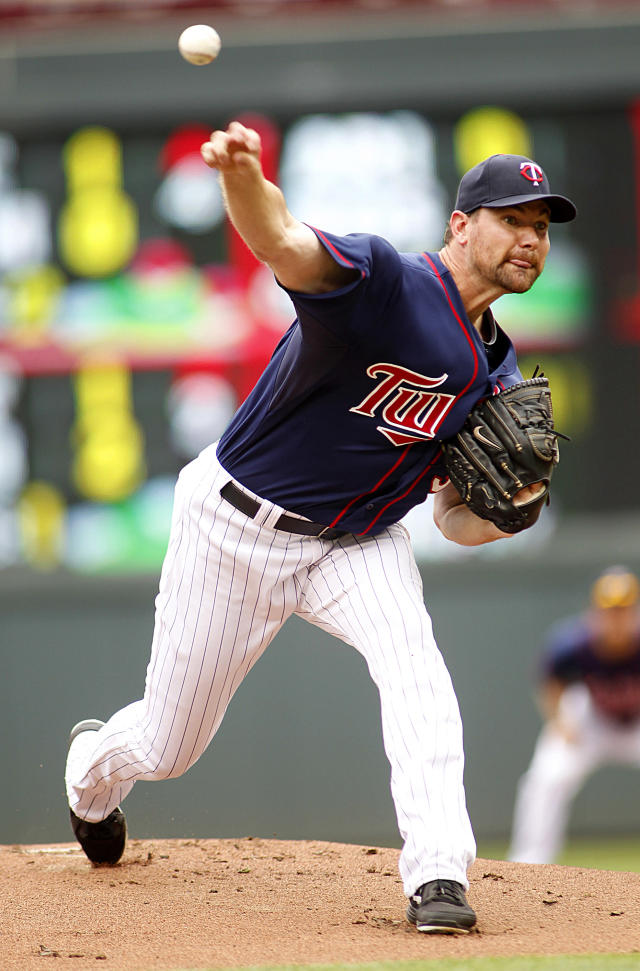 Minnesota Twins starting pitcher Mike Pelfrey throws to the Houston Astros in the first inning of their baseball game in Minneapolis, Sunday, Aug. 4, 2013. (AP Photo/Andy Clayton-King)