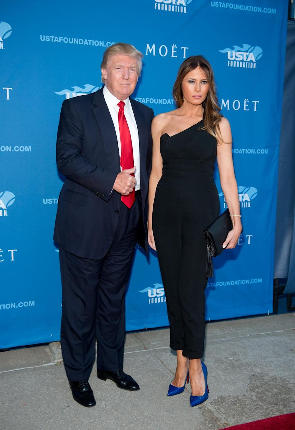 <p>Still favouring the flattering look of a tailored jumpsuit, Melania wore a tight-fitting style with blue Louboutins for a gala. <i>[Photo: Getty]</i> </p>