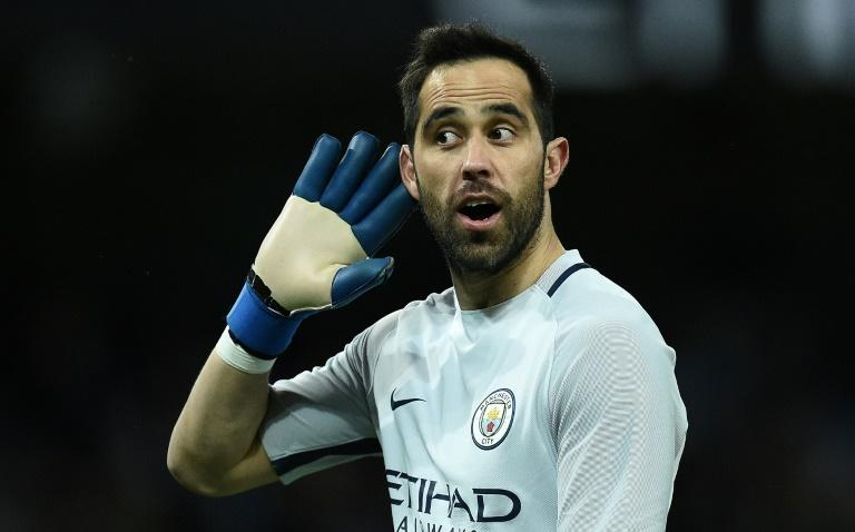 Manchester City's Chilean goalkeeper Claudio Bravo gestures to Huddersfield fans at the Etihad Stadium on March 1, 2017