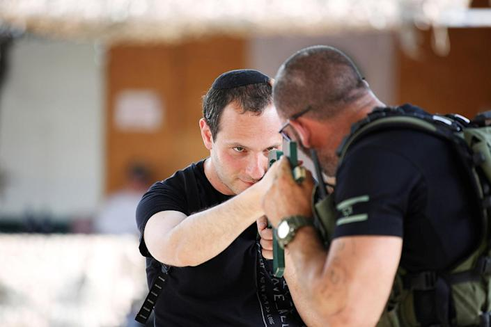 "<p>A tourist takes part in a two hour ""boot camp"" experience, at ""Caliber 3 Israeli Counter Terror and Security Academy "" in the Gush Etzion settlement bloc south of Jerusalem in the occupied West Bank July 13, 2017. (Photo: Nir Elias/Reuters) </p>"