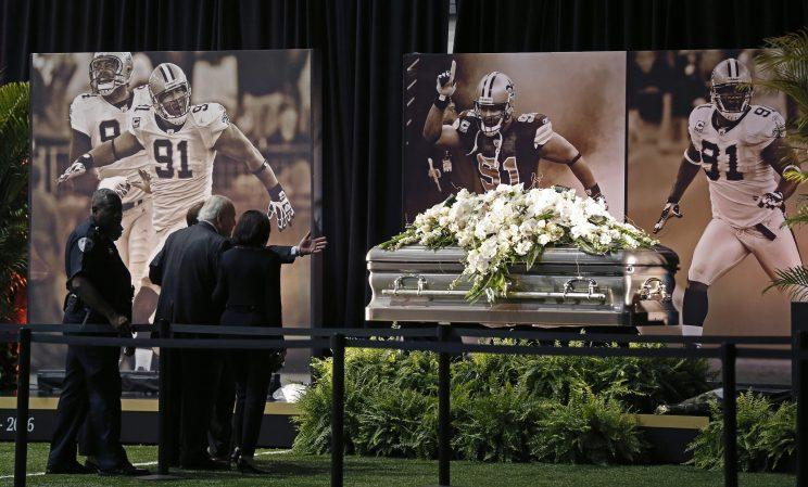 New Orleans Saints owner Tom Benson views the casket of Will Smith during a viewing in April. (AP)