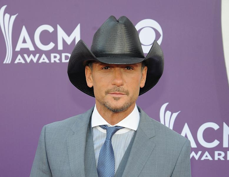 FILE - This April 7, 2013 file photo shows singer Tim McGraw at the 48th Annual Academy of Country Music Awards at the MGM Grand Garden Arena in Las Vegas. Curb Records has sued Tim McGraw and Big Machine Records in federal court, alleging copyright infringement and breach of contract. (Photo by Al Powers/Invision/AP, file)