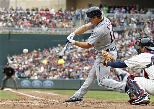 Detroit Tigers' Andy Dirks swings into a two-run RBI double in the fifth inning off Minnesota Twins pitcher Carl Pavano during their baseball game in Minneapolis, Saturday, May 26, 2012. (AP Photo/Andy King)