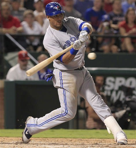 Toronto Blue Jays shortstop Yunel Escobar takes a strike during the sixth inning of a baseball game against the Texas Rangers Friday, May 25, 2012, in Arlington, Texas. (AP Photo/LM Otero)