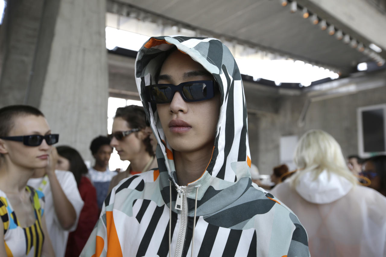 Models wait backstage prior to the Sunnei men's 2019 Spring-Summer collection, unveiled during the Fashion Week in Milan, Italy, Sunday, June 17, 2018. (AP Photo/Luca Bruno)