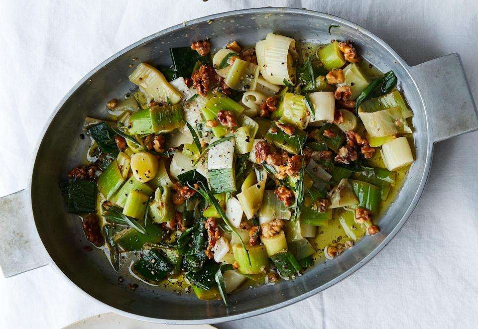 """Cutting the leeks into rounds is an update on the classic presentation—and makes them easier to serve to a crowd. <a href=""""https://www.bonappetit.com/recipe/leeks-in-vinaigrette-with-walnuts-and-tarragon?mbid=synd_yahoo_rss"""" rel=""""nofollow noopener"""" target=""""_blank"""" data-ylk=""""slk:See recipe."""" class=""""link rapid-noclick-resp"""">See recipe.</a>"""