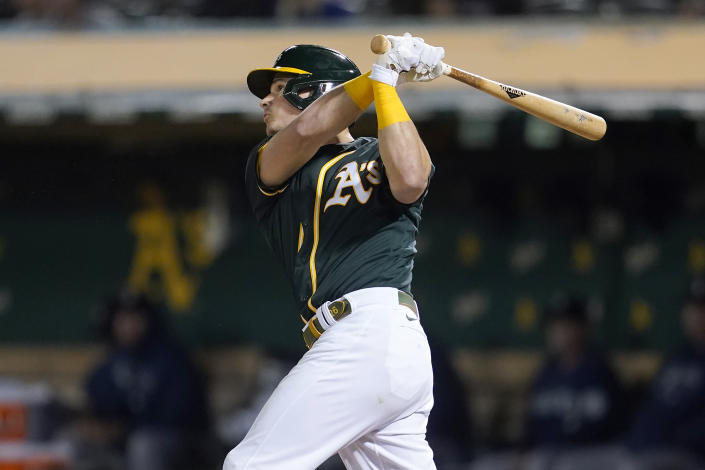 Oakland Athletics' Matt Chapman hits a home run against the Seattle Mariners during the fifth inning of a baseball game in Oakland, Calif., Wednesday, Sept. 22, 2021. (AP Photo/Jeff Chiu)