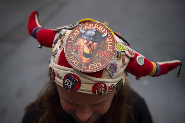 <p>A barman poses for a photograph in a whacky hat at the CAMRA (Campaign for Real Ale) Great British Beer festival at Olympia exhibitioncenter on August 8, 2017 in London, England. (Photo: Carl Court/Getty Images) </p>