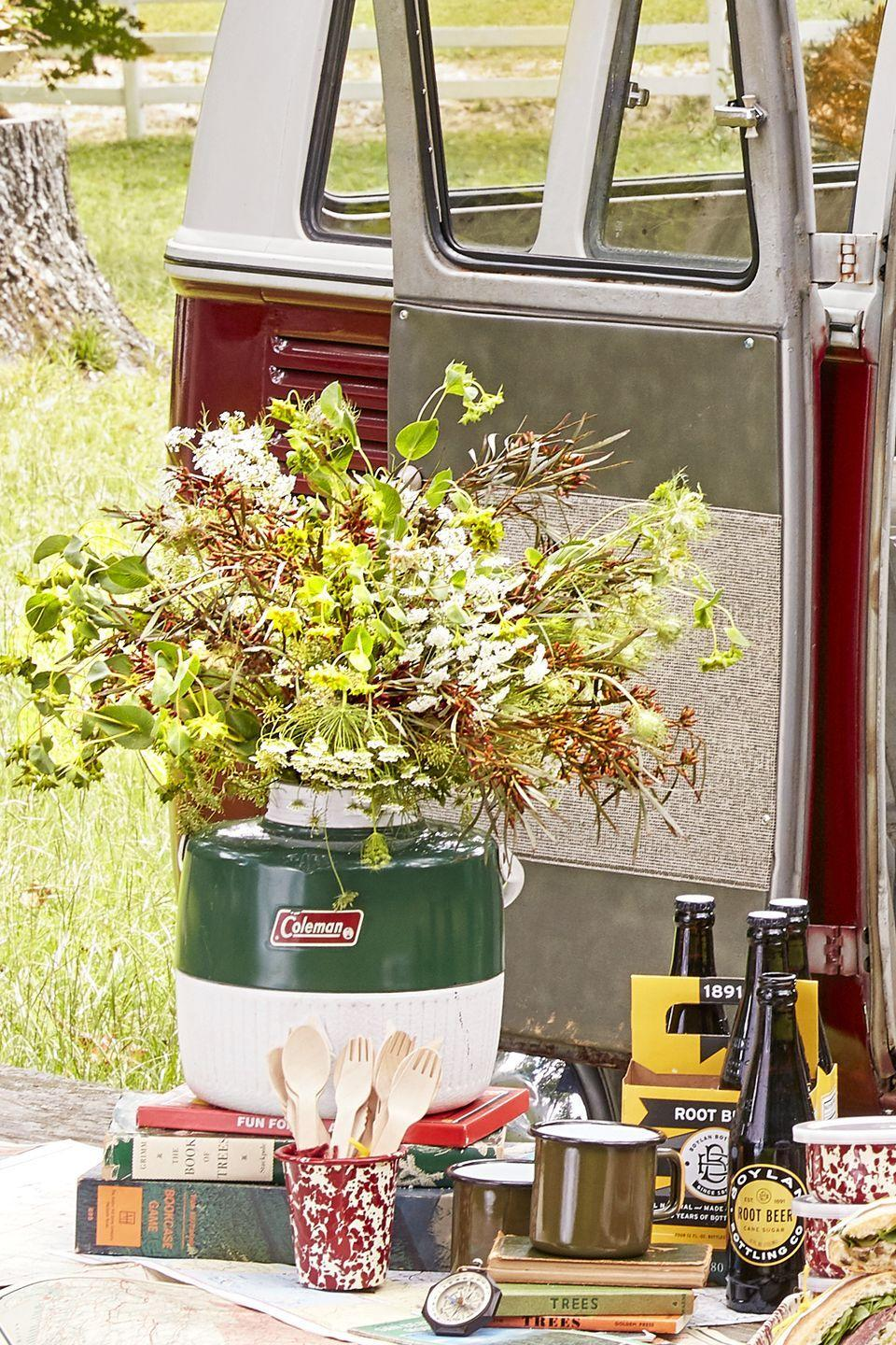 """<p>If Thanksgiving tends to be a casual shindig in your home, use a vintage jug cooler and foraged branches, leaves, and flowers from your backyard.</p><p><a class=""""link rapid-noclick-resp"""" href=""""https://go.redirectingat.com?id=74968X1596630&url=https%3A%2F%2Fwww.ebay.com%2Fsch%2Fi.html%3F_from%3DR40%26_trksid%3Dm570.l1313%26_nkw%3Dvintage%2Bjug%2Bcoolers%26_sacat%3D0%26LH_TitleDesc%3D0%26_osacat%3D0%26_odkw%3Dvintage%2Bcoolers&sref=https%3A%2F%2Fwww.countryliving.com%2Fentertaining%2Fg2130%2Fthanksgiving-centerpieces%2F"""" rel=""""nofollow noopener"""" target=""""_blank"""" data-ylk=""""slk:SHOP VINTAGE COOLERS"""">SHOP VINTAGE COOLERS</a></p>"""