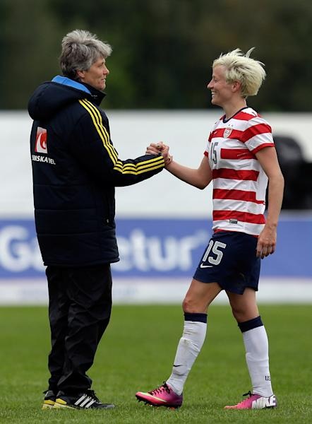 Megan Rapinoe, right, of the US, shakes hands with Sweden's head coach Pia Sundhage at the end of their Algarve Cup women's soccer match Monday, March 11 2013, in Lagos, southern Portugal. The game ended in a 1-1 draw. Sundhage previously coached the US team. (AP Photo/Armando Franca)