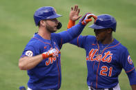 New York Mets' Pete Alonso, left, is greeted by Mallex Smith (21) after hitting a grand slam during the fifth inning of a spring training baseball game against the Washington Nationals, Thursday, March 4, 2021, in Port St. Lucie, Fla. (AP Photo/Lynne Sladky)