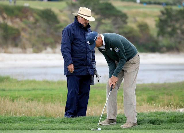 "<div class=""caption""> Matt Kuchar gets a ruling from White after he had tried to get a drop from a USGA rules official on the par-3 17th hole during the 2019 U.S. Open. </div> <cite class=""credit"">David Cannon/Getty Images</cite>"
